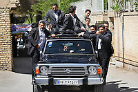 President Mahmoud Ahmadinejad sits in his armoured Nissan jeep with gun-carrying bodyguards hanging on to all sides of the car, as he is driven to deliver a speech in the central Iranian town of Isfahan (Esfahan). On each trip he makes, Mr Ahmadinejad is accompanied by up to 100 bodyguards as he claims that Western intelligence organizations are planning to assassinate him.