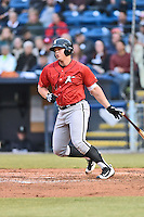 Kannapolis Intimidators first baseman Corey Zangari (14) swings at a pitch during a game against the Asheville Tourists at McCormick Field on May 19, 2016 in Asheville, North Carolina. The Intimidators defeated the Tourists 10-7. (Tony Farlow/Four Seam Images)