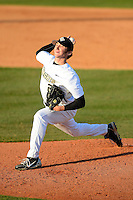 Central Florida Knights pitcher Tyler Martin #23 during a game against the Siena Saints at Jay Bergman Field on February 16, 2013 in Orlando, Florida.  Siena defeated UCF 7-4.  (Mike Janes/Four Seam Images)