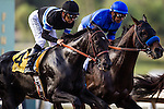 September 27 2014: Shared Belief with Mike Smith gets pushed wide on the turn by Sky Kingdom in the Awesome Again Stakes at Santa Anita Park in Arcadia CA. Alex Evers/ESW/CSM