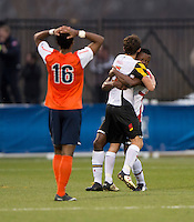 Suli Dainkeh (22) and Mikey Ambrose (5) of Maryland celebrate the win as Marcus Salady-Defour (16) of Virginia walks away after the ACC Finals at the Maryland SoccerPlex in Boyds, MD.  Maryland defeated Virginia, 1-0, to win the title.