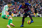 Malcom Filipe Silva de Oliveira of FC Barcelona (R) is tackled by Jose Andres Guardado Hernandez of Real Betis  during the La Liga 2018-19 match between FC Barcelona and Real Betis at Camp Nou, on November 11 2018 in Barcelona, Spain. Photo by Vicens Gimenez / Power Sport Images