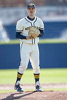 Michigan Wolverines pitcher Steven Hajjar (27) looks to his catcher for the sign to the plate during the NCAA baseball game against the Illinois Fighting Illini at Fisher Stadium on March 19, 2021 in Ann Arbor, Michigan. Illinois won the game 7-4. (Andrew Woolley/Four Seam Images)