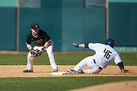 Zack Miller (46) of the Catawba Indians slides into second base ahead of the tag from Austin Martin (11) of the West Virginia State Yellow Jackets at Newman Park on February 9, 2020 in Salisbury, North Carolina. The Indians defeated the Yellow Jackets 15-9 in game one of a doubleheader.  (Brian Westerholt/Four Seam Images)