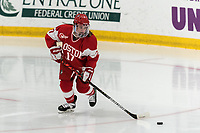WORCESTER, MA - FEBRUARY 08: Breanna Scarpaci #17 of Boston University brings the puck forward during a game between Boston University and College of the Holy Cross at Hart Center Rink on February 08, 2020 in Worcester, Massachusetts.