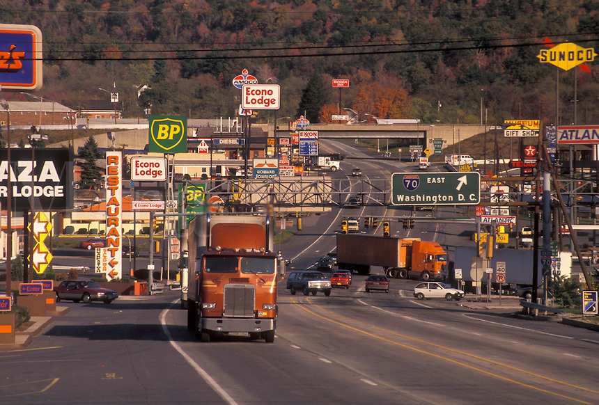 AJ3182, Pennsylvania, Truck driving up Route 30 with signs, advertisements, and billboards on both sides of the highway in Breezewood (intersection of PA Turnpike I76, I70 and I99) in the state of Pennsylvania.