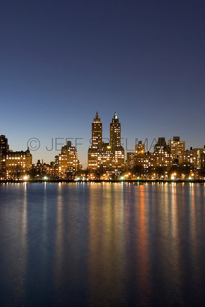 AVAILABLE FROM JEFF AS A FINE ART PRINT.<br /> <br /> AVAILABLE SOON FROM WWW.CORBIS.COM FOR COMMERCIAL AND EDITORIAL LICENSING.  I'll post the Corbis ID# as soon as it's available.<br /> <br /> Skyline of Manhattan's Upper West Side at Dusk Viewed from the Central Park Reservoir, New York City, New York State, USA<br /> <br /> The double-towered building in the center of the photo is The Eldorado luxury co-op apartment building at 300 Central Park West, between West 90th Street and West 91st Street.  The building was constructed between 1929 and 1931 in the Art Deco style.  <br /> <br /> Author Sinclair Lewis lived in one of the tower apartments in the past.  More recent residents have included Alec Baldwin, Faye Dunaway, Moby, Garrison Keillor and Michael J. Fox.<br /> <br /> The Central Park Reservoir is also known as The Jaqueline Kennedy Onassis Reservoir.