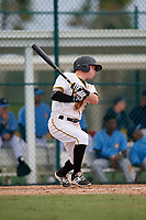 Pittsburgh Pirates Mitchell Tolman (31) follows through on a swing during an Instructional League game against the Tampa Bay Rays on October 3, 2017 at Pirate City in Bradenton, Florida.  (Mike Janes/Four Seam Images)