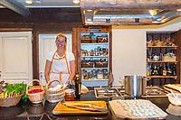 Estonia, Muhu Island. Muhu Jaanalind, guest house and farm. Ingrem Raidjoe (Daughter & owner), cooking lunch.