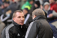Pictured L-R: Brendan Rodgers amanger for Swansea greets Roy Hodgson, manage for West Bromwich Albion. Saturday, 04 February 2012<br /> Re: Premier League football, West Bromwich Albion v Swansea City FC v at the Hawthorns Stadium, Birmingham, West Midlands.