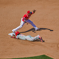 24 May 2015: Washington Nationals shortstop Ian Desmond gets Odubel Herrera out on a force play at second during a game against the Philadelphia Phillies at Nationals Park in Washington, DC. The Nationals defeated the Phillies 4-1 to take the rubber game of their 3-game weekend series. Mandatory Credit: Ed Wolfstein Photo *** RAW (NEF) Image File Available ***