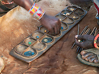 "Maasai tribesmen playing the game Bao, a type of Mancala (""count and capture"") Board game commonly played in east Africa. Tipilit village near Amboseli National Park, Kenya"