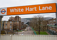 White Hart Lane overground station sign with Tottenham Hotspur Stadium in the distance at High Road (White Hart Lane), London, England on 19 March 2019. Photo by Andy Rowland.