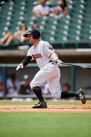 Birmingham Barons center fielder Ryan Brett (15) follows through on a swing during a game against the Pensacola Blue Wahoos on May 9, 2018 at Regions FIeld in Birmingham, Alabama.  Birmingham defeated Pensacola 16-3.  (Mike Janes/Four Seam Images)