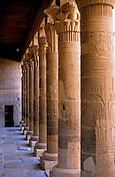 Colonnade marking the entrance to the ancient remains of a temple for Isis on the island of Philae on the Nile river, Egypt.