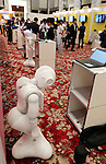 July 20, 2016, Tokyo, Japan - Softbank's humanoid robot Pepper takes a rest while others are working at a press preview of the Pepper World exhibition in Tokyo on Wednesday, July 20, 2016. Pepper's latest applications and accessories will be exhibited at the Pepper World robot exhibition on July 21 and 22.      (Photo by Yoshio Tsunoda/AFLO)