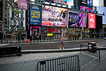 The Naked Cowboy performer stands in a nearly empty Times Square in New York, U.S., on Thursday, March 19, 2020. New York state Governor Andrew Cuomo on Thursday ordered businesses to keep 75% of their workforce home as the number of coronavirus cases rises rapidly. Photograph by Michael Nagle/Redux