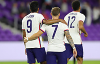 ORLANDO CITY, FL - JANUARY 31: Paul Arriola #7 of the United States scores a goal and celebrates during a game between Trinidad and Tobago and USMNT at Exploria stadium on January 31, 2021 in Orlando City, Florida.