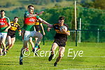 Mikey CAsey Dr Crokes goes past Donal Maher Kilcummin during their Div 1A SFL game in Kilcummin on Friday