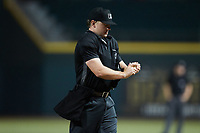 Home plate umpire Dylan Bradley during the game between the Greensboro Grasshoppers and the Winston-Salem Dash at Truist Stadium on August 11, 2021 in Winston-Salem, North Carolina. (Brian Westerholt/Four Seam Images)