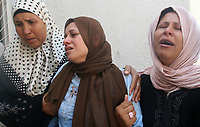 "Relatives react after two Palestinian children were killed in Gaza August 7, 2007. A rocket fired at Israel by Palestinian militants on Tuesday fell short and killed two Palestinian children in the Gaza Strip, ambulance crews said.""photo by Fady Adwan"""