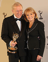 NEW YORK CITY. Nov23.  Sir David Frost backstage with Barbara Walters after being presented with a Founders award at the 37th International Emmy Awards at the Hilton in New York City.Trevor Collens/ Photoshot