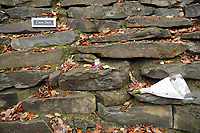Pictured: Flowers and tributes left at the entrance to the property in Llangammarch Wells, Powys, Wales, UK. Tuesday 31 October 2017<br /> Re: Investigations continue into a house fire in which a father and several of his children have died.<br /> Three children aged 13, 12 and 10 escaped the farmhouse in Llangammarch Wells, Powys, in the early hours of Monday and raised the alarm.<br /> Police said they could not identify the deceased or confirm numbers.<br /> One of those missing has been named locally as David Cuthbertson.