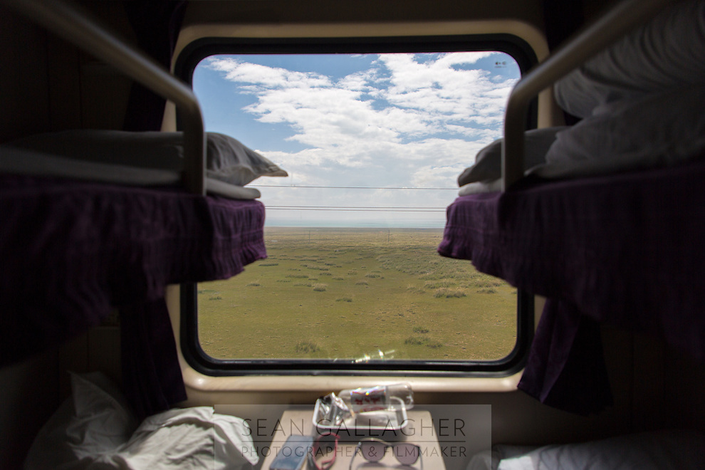 The view while riding the Xining to Lhasa train, a 24-hour journey that takes passengers across highland grasslands and through mountain passes into Tibet. It's regarded as one of the most interesting and visually spectacular train journeys in all of China.