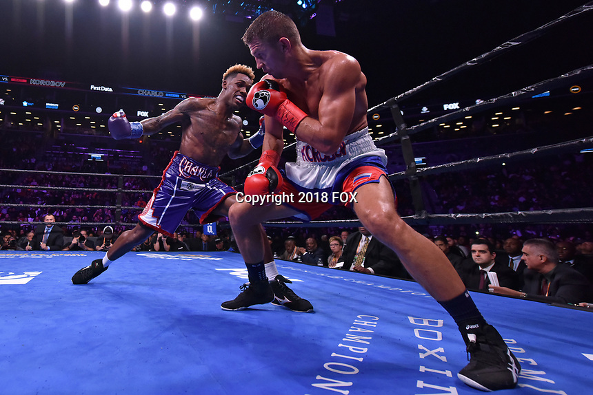 """BROOKLYN, NY - DECEMBER 22: (L-R) American boxer Jermall Charlo and russian boxer Matt Korobov fight for the WBC Interim Middleweight Championship during the Fox Sports and Premier Boxing Champions  December 22 """"PBC on Fox"""" Fight Night at the Barclays Center on December 22, 2018 in Brooklyn, New York. (Photo by Anthony Behar/Fox Sports/PictureGroup)"""