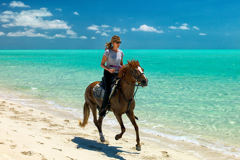 Horse rider ion beach. Providenciales. Turks and Caicos.