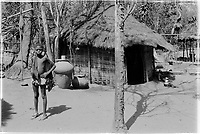 Boy in a village in the liberated areas. Earthenware vessels.1974