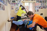 Physio Jeroen Deen treating Wilson Kipsang while Abel Kirui waits for his treatment in Iten, Kenya.