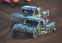 Dec. 11, 2011; Chandler, AZ, USA;  LOORRS pro 2 driver Jeremy McGrath leads Rob MacCachren during the Lucas Oil Challenge Cup at Firebird International Raceway. Mandatory Credit: Mark J. Rebilas-