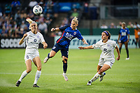 TACOMA, WA - JULY 31: Jessica Fishlock #10 of the OL Reign heads the ball during a game between Racing Louisville FC and OL Reign at Cheney Stadium on July 31, 2021 in Tacoma, Washington.