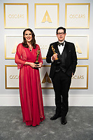 Alice Doyard and Anthony Giacchino pose backstage with the Oscar® for Documentary Short Subject during the live ABC Telecast of The 93rd Oscars® at Union Station in Los Angeles, CA on Sunday, April 25, 2021.<br /> *Editorial Use Only*<br /> ©A.M.P.A.S.<br /> Image supplied by Capital Pictures