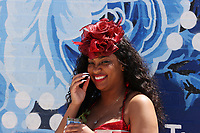 30th April 2021; Kentucky, USA;  A spectator wears a hat during Oaks Day on April 30, 2021 at Churchill Downs in Louisville, Kentucky.