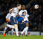 Nicky Clark heads in the opening goal for Rangers