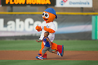 Burlington Royals mascot Bingo races a young fan around the bases between innings of the game against the Kingsport Mets at Burlington Athletic Stadium on July 18, 2016 in Burlington, North Carolina.  The Royals defeated the Mets 8-2.  (Brian Westerholt/Four Seam Images)