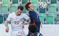 ST. GALLEN, SWITZERLAND - MAY 30: Josh Sargent #9 of the United States heads a ball during a game between Switzerland and USMNT at Kybunpark on May 30, 2021 in St. Gallen, Switzerland.