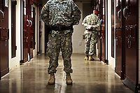 Guards at the maximum security wing (Camp V), part of Camp Delta at the American naval base at Guantanamo Bay, where over 600 alleged al Qaeda members have been held indefinitely. Described by the US as 'unlawful enemy combatants', they were captured primarily in Afghanistan during the 'war against terror'.