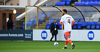 Blackpool's Grant Ward during the pre-match warm-up wearing a t-shirt in tribute to Warren Green, Blackpool's academy manager, who died aged 46<br /> <br /> Photographer Chris Vaughan/CameraSport<br /> <br /> The EFL Sky Bet League One - Peterborough United v Blackpool - Saturday 21st November 2020 - London Road Stadium - Peterborough<br /> <br /> World Copyright © 2020 CameraSport. All rights reserved. 43 Linden Ave. Countesthorpe. Leicester. England. LE8 5PG - Tel: +44 (0) 116 277 4147 - admin@camerasport.com - www.camerasport.com