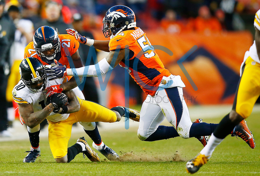 Martavis Bryant #10 of the Pittsburgh Steelers is tackled by Aqib Talib #21 of the Denver Broncos in the second half against the Denver Broncos during the AFC Divisional Round Playoff game at Sports Authority Field at Mile High on January 17, 2016 in Denver, Colorado. (Photo by Jared Wickerham/DKPittsburghSports)