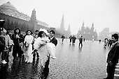 """Moscow, Russia<br /> October 19, 1992<br /> <br /> A wedding in Red Square.<br /> <br /> In December 1991, food shortages in central Russia had prompted food rationing in the Moscow area for the first time since World War II. Amid steady collapse, Soviet President Gorbachev and his government continued to oppose rapid market reforms like Yavlinsky's """"500 Days"""" program. To break Gorbachev's opposition, Yeltsin decided to disband the USSR in accordance with the Treaty of the Union of 1922 and thereby remove Gorbachev and the Soviet government from power. The step was also enthusiastically supported by the governments of Ukraine and Belarus, which were parties of the Treaty of 1922 along with Russia.<br /> <br /> On December 21, 1991, representatives of all member republics except Georgia signed the Alma-Ata Protocol, in which they confirmed the dissolution of the Union. That same day, all former-Soviet republics agreed to join the CIS, with the exception of the three Baltic States."""