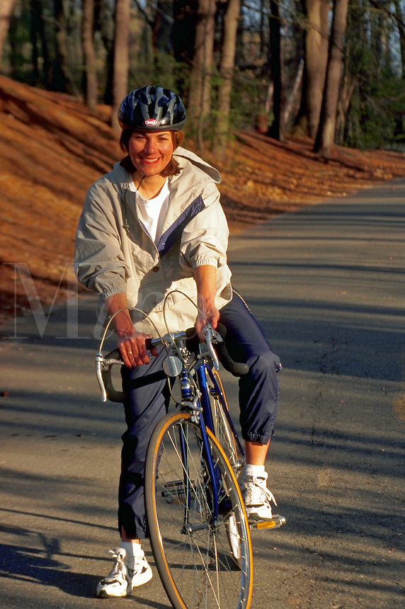 Woman in her 40s on her bicycle.