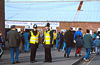 Police officers performing body searches on football fans before they enter a football club to watch a match. They are checking to ensure that the fans are not concealing offensive weapons of any description. This image may only be used to portray the subject in a positive manner..©shoutpictures.com..john@shoutpictures.com