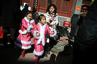 CHINA. Young children during Chinese New Year in Baiyun Temple in Beijing.  Chinese New Year, or Spring Festival, is the most important festival and holiday in the Chinese calendar In mainland China, many people use this holiday to visit family and friends and also visit local temples to offer prayers to their ancestors. The roots of Chinese New Year lie in combined influences from Buddhism, Taoism, Confucianism, and folk religions.  2008.