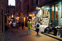 Montreal, Canada, Quebec, Street artists display their work along a pedestrian street at the Old Port (Vieux Port) at night in Old Montreal (Vieux Montreal) in Quebec.