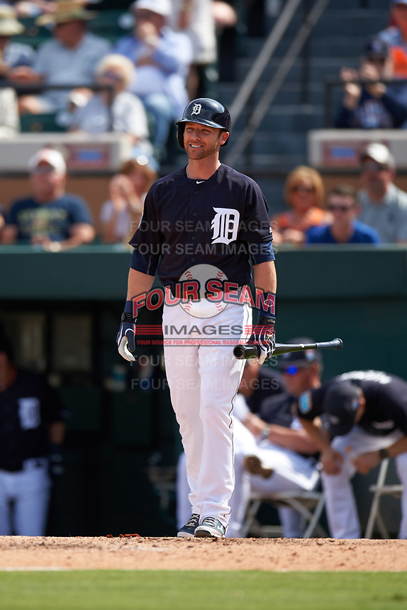 Detroit Tigers Andrew Romine (17) waits at home plate to congratulate Austin Green (not shown) after hitting a home run during an exhibition game against the Florida Southern Moccasins on February 29, 2016 at Joker Marchant Stadium in Lakeland, Florida.  Detroit defeated Florida Southern 7-2.  (Mike Janes/Four Seam Images)