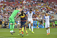 Santa Clara, CA - Friday June 03, 2016: Colombia goalkeeper David Ospina (1) punches a ball clear as defender Cristián Zapata (2) and United States forward Clint Dempsey (8) go for a header during a Copa America Centenario Group A match between United States (USA) and Colombia (COL) at Levi's Stadium.