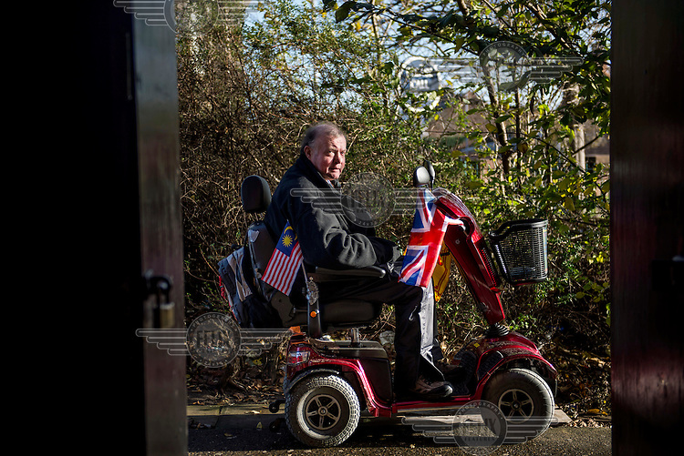 Charles Kennedy, the eighth Marquess (Marquis) of Ailsa, on his mobility scooter outside the Market Inn pub in Ayr.